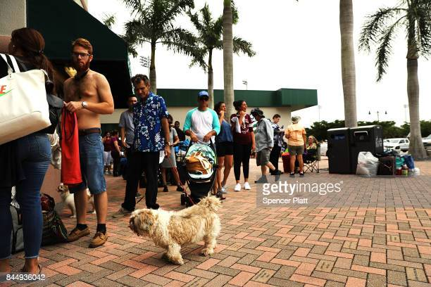 People arrive at a shelter at Alico Arena where thousands of Floridians are hoping to ride out Hurricane Irma on September 9 2017 in Fort Myers...