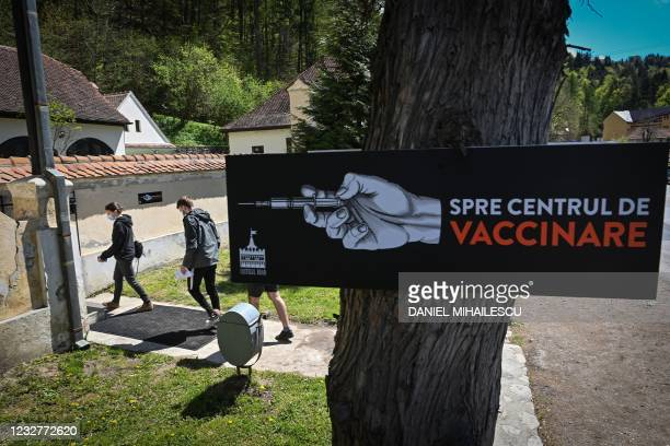 "People arrive at a vaccination center during the vaccination marathon organised at the ""Bran Castle"" in Bran village on May 8, 2021. - Romanian..."