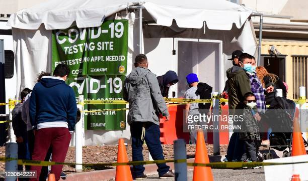 People arrive at a walk-up Covid-19 testing site at Lincoln Park in Los Angeles, California on January 28, 2021. - The daily number of deaths from...