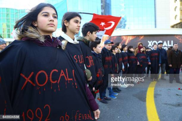 People arrive at Ana feryadi monument during the 25th anniversary of Khojaly Massacre in Baku Azerbaijan on February 26 2017 The massacre on February...