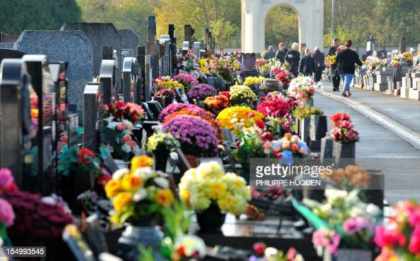 People arrive at cemeterg on October 30 2012 in Oignies northern France two days before the traditional November 1 All Saints religious feast AFP...