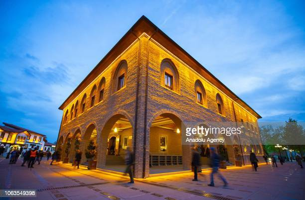People arrive at Haci Bayram Veli Mosque to attend a religious ceremony within the celebrations for Mawlid alNabi the birth anniversary of Muslims'...