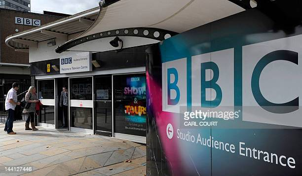 People arrive at one of the entrances to the BBC Television offices in west London on October 6 2011 The British Broadcasting Corporation said on...