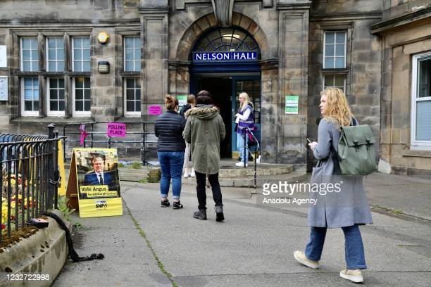 People arrive at polling stations to cast their votes for Scottish Parliament election in Edinburgh, Scotland, United Kingdom on May 06, 2021.