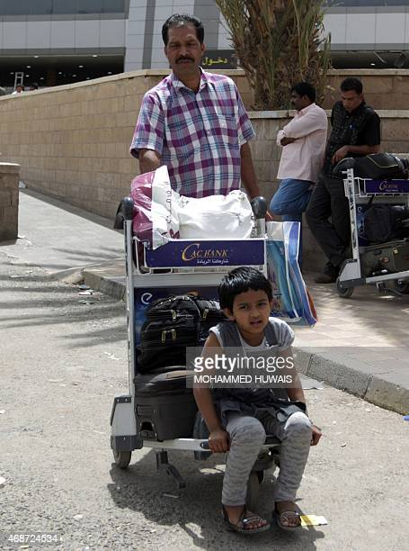 People arrive at Sanaa International Airport on April 6 2015 as hundreds of foreigners are evacuated from conflicthit Yemen On the 12th day of the...