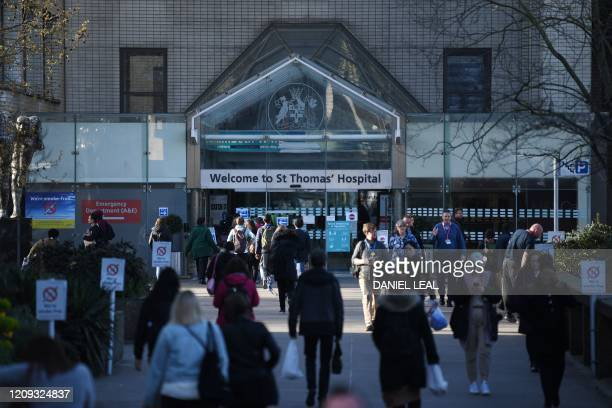 People arrive at St Thomas' hospital in central London where Britain's Prime Minister Boris Johnson is in intensive care on April 7 2020 British...