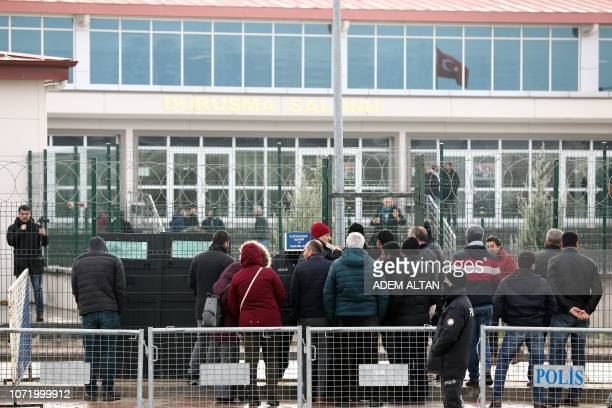 People arrive at the courthouse in Ankara to attend the hearing of the proKurdish party Peoples' Democratic Party former coleader Selahattin Demirtas...