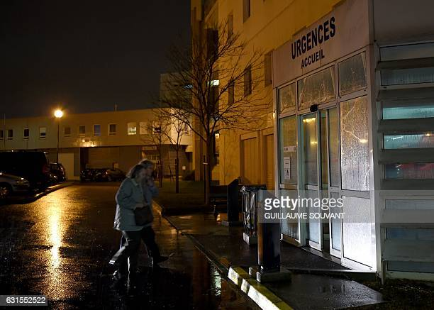 People arrive at the emergency department of the hospital of Trousseau in Tours on January 12 2017 French hospitals are being stretched to their...