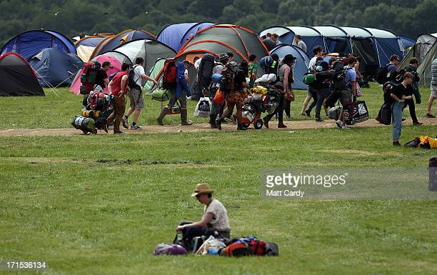 People arrive at the Glastonbury Festival of Contemporary Performing Arts site at Worthy Farm in Pilton at Worthy Farm Pilton on June 26 2013 near...