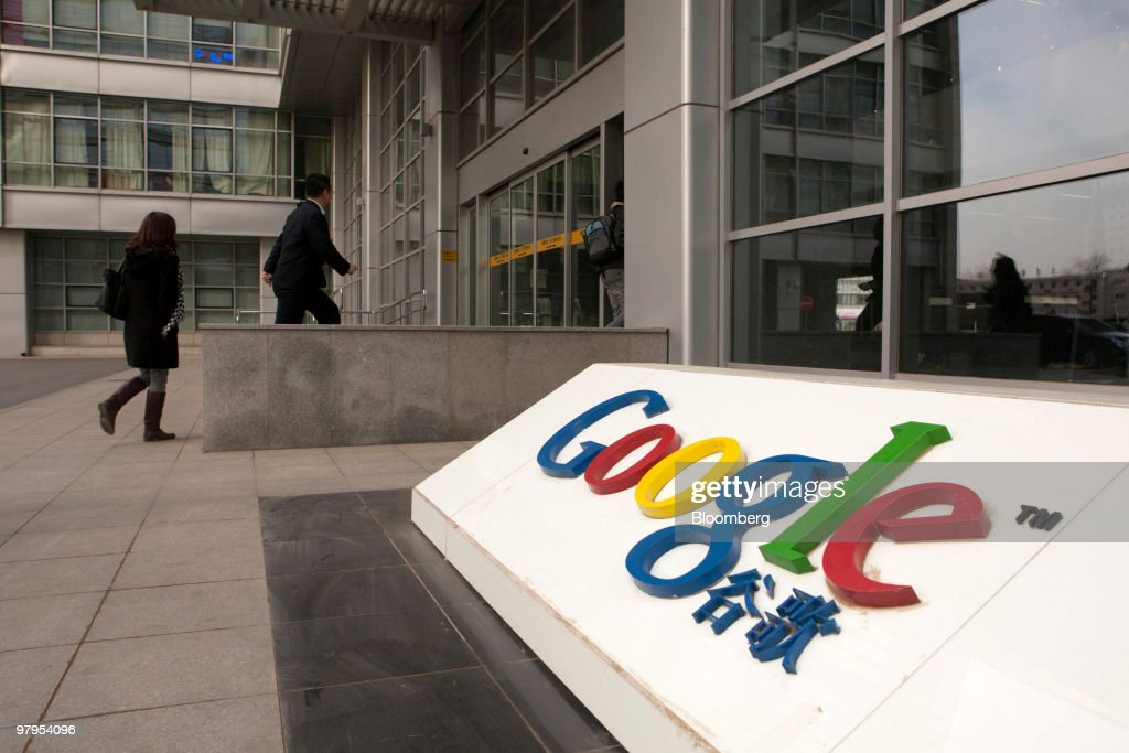People arrive at the Google Inc. office in Beijing, China, on Tuesday, March 23, 2010. Google Inc., following through on a pledge to stop censoring search results in China, began serving mainland Chinese users via its unfiltered Hong Kong site, a move that could prompt the government to block the service. Photographer: Adam Dean/Bloomberg via Getty Images