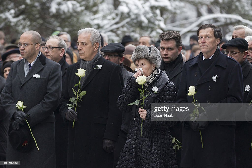 People arrive at the Heidefriedhof cemetery and memorial to commemorate the 68th anniversary of the Allied firebombing of Dresden during World War II on February 13, 2013 in Dresden, Germany. Critics charge the bombing targeted the cultural center and civilian population of the city, of whom approximately 22,000 were killed. British and American bombers took part in the raid that took place in the final months of the war.