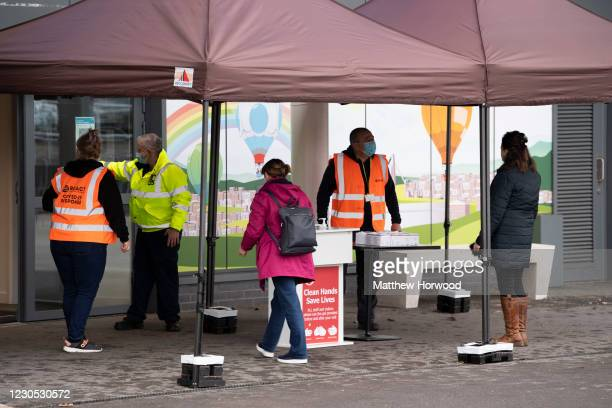 People arrive at the mass vaccination centre at Ashton Gate Stadium on January 11, 2021 in Bristol, England. The location is one of several mass...