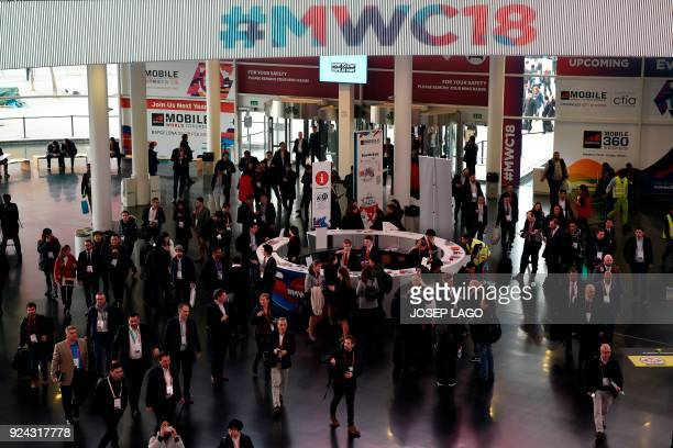 People arrive at the Mobile World Congress on February 26 2018 in Barcelona The Mobile World Congress the world's biggest mobile fair is held in...