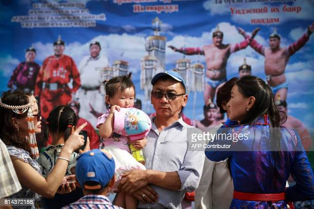 People arrive at the opening ceremony of the traditional Nadaam festival in Ulan Bator on July 11 2017 The festivities consist of a number of...