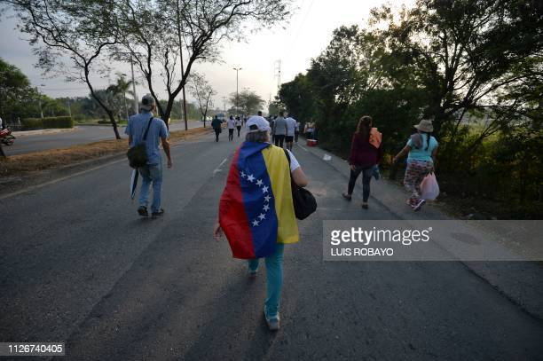 People arrive at the place where Venezuela Aid Live concert will be held at Tienditas International Bridge in Cucuta Colombia on February 22 2019 The...
