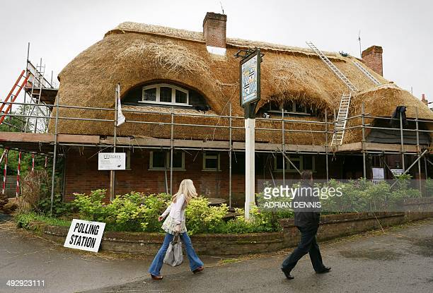 People arrive at the Tichborne Arms free house pub which is doubling as a Polling Station near Winchester some 65 miles west of London on May 22 2014...