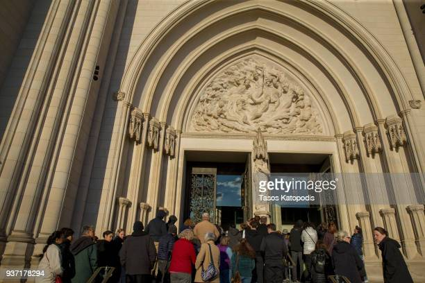 People arrive at the Washington National Cathedral for a interfaith prayer vigil with activists students pilgrims and the parents of Carmen Schentrup...