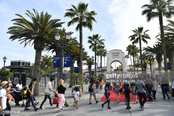 People arrive at Universal City's Universal Studios Hollywood near Los Angeles on June 15 as California re-opens, lifting its Covid-19 restrictions.