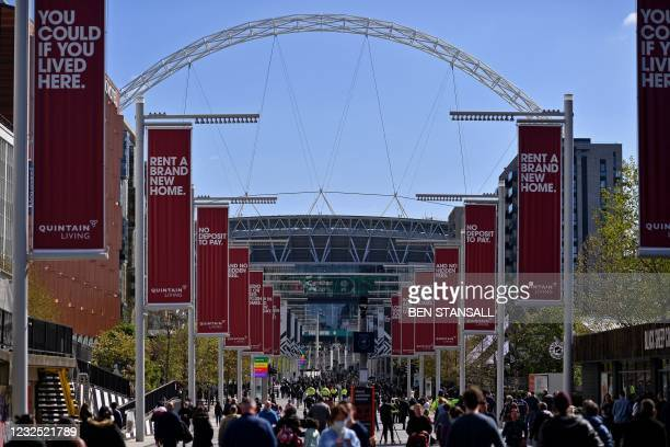 People arrive at Wembley Stadium to watch the English League Cup final football match between Manchester City and Tottenham Hotspur, in northwest...