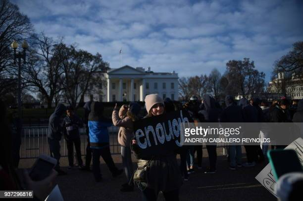 People arrive early for the March For Our Lives rally against gun violence in front of the White House in Washington, DC on March 24, 2018.