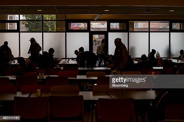 People arrive for a free meal at St Anthony's dining room in the Tenderloin district of San Francisco California US on Tuesday Jan 20 2015 In a city...