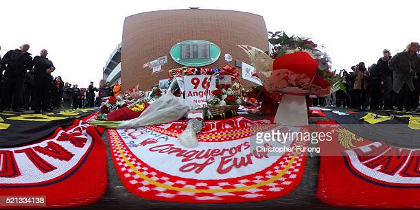People arrive for a memorial service to mark the 27th anniversary of the Hillsborough disaster at Anfield stadium on April 15 2016 in Liverpool...