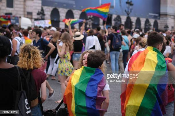 People arrive for a rally ahead of the Paris Gay Pride Parade or known as Marche des Fiertes LGBT in France at the Place de la Concorde on June 24...
