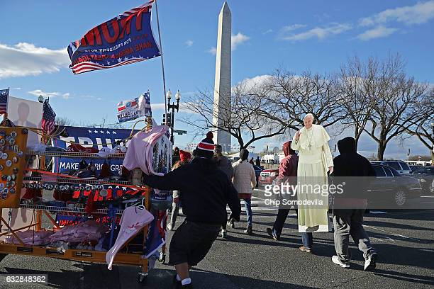 People arrive for a rally before the start of the 44th annual March for Life at the base of the Washington Monument January 27 2017 in Washington DC...