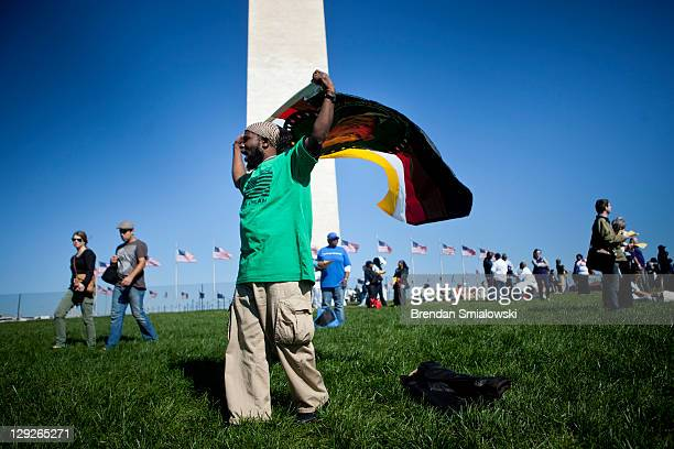 People arrive for a rally on the National Mall October 15 2011 in Washington DC Activists gathered for the annual rally to celebrate the American...