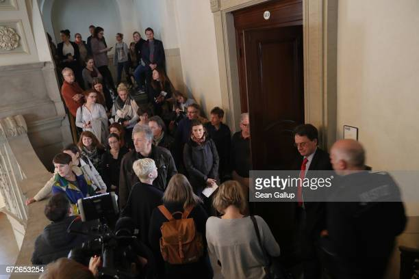 People arrive for the first day of a legal appeal by a woman against Facebook at the Kammergericht courthouse on April 25 2017 in Berlin Germany The...