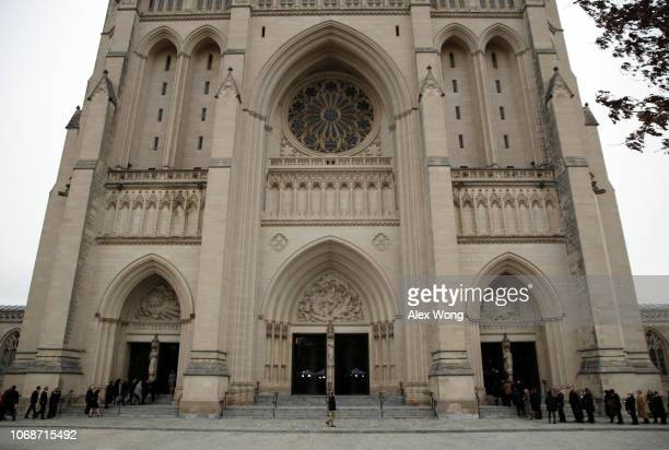 People arrive for the funeral of late former US President George HW Bush at the Washington National Cathedral December 5 2018 in Washington DC...