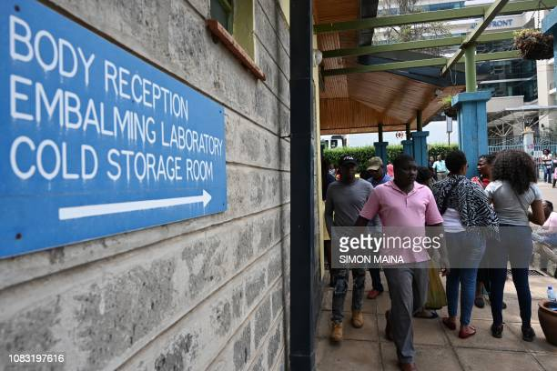 People arrive for the identification of the victims at the Chiromo mortuary in Nairobi Kenya on January 16 2019 after a blast followed by a gun...