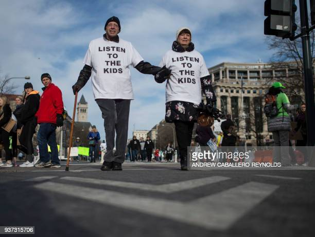 TOPSHOT People arrive for the March For Our Lives rally against gun violence in Washington DC on March 24 2018 Galvanized by a massacre at a Florida...