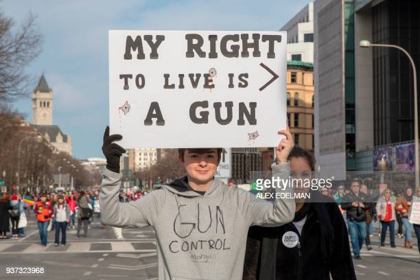 People arrive for the March For Our Lives rally against gun violence in Washington DC on March 24 2018 Galvanized by a massacre at a Florida high...