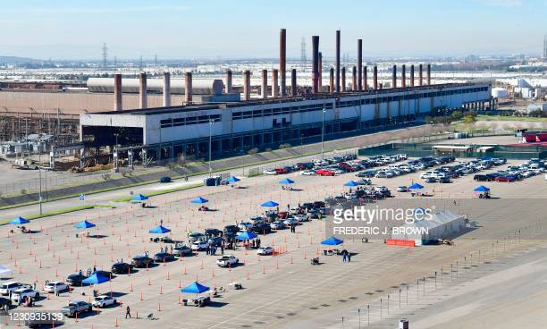 People arrive for their Covid-19 vaccine at the Auto Club Speedway in Fontana, California on February 2, 2021 - The first Covid-19 vaccine 'super...