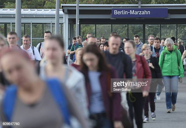 People arrive from a commuter train in Marzahn district on September 21, 2016 in Berlin, Germany. In Berlin state elections held three days before...