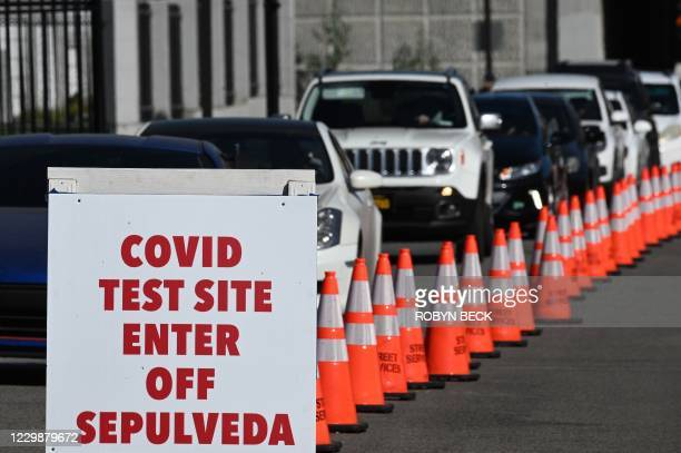 People arrive in cars for Covid-19 tests at a coronavirus testing site in Los Angeles, California on November 30, 2020 following the Thanksgiving...