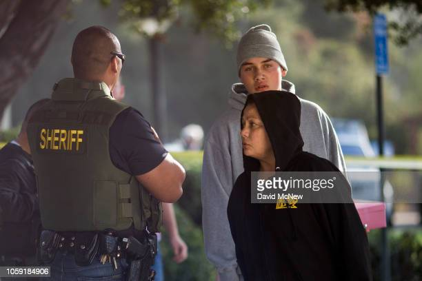 People arrive to a family assistance and reunification center following a mass shooting at the Borderline Bar and Grill on November 8 2018 in...