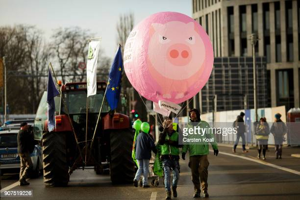 People arrive to a march to demonstrate against the agroindustry on January 20 2018 in Berlin Germany Marchers whose protest is coinciding with the...