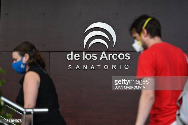People arrive to a private clinic where late former Argentine President and Senator, Carlos Saul Menem died in Buenos Aires on February 14, 2021. -...