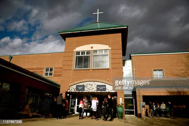 People arrive to attend Columbine 20 Years Later A Faithbased Remembrance Service for the victims of the Columbine High School shooting at Waterstone...