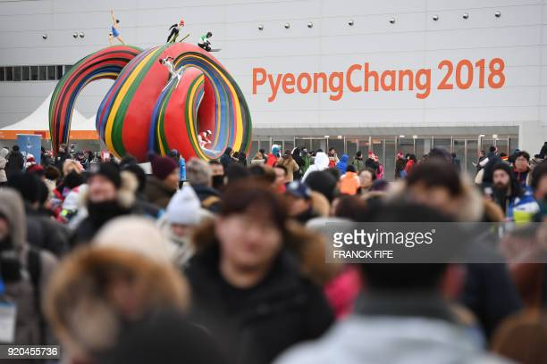 People arrive to attend the medal ceremonies at the Pyeongchang Medals Plaza during the Pyeongchang 2018 Winter Olympic Games in Pyeongchang on...