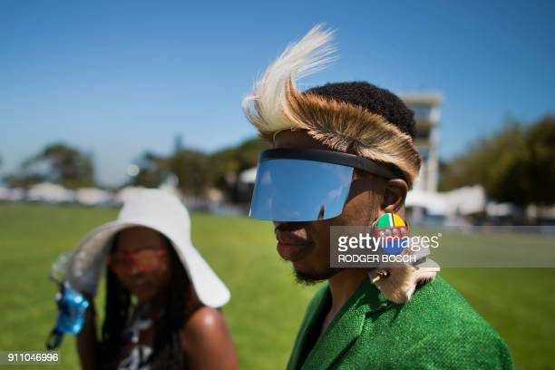 People arrive to attend the Met horse race at Kenilworth race track on January 27 in Cape Town The Met is one of South Africa's premier horse races...