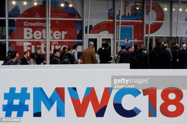 People arrive to attend the Mobile World Congress on February 26 2018 in Barcelona The Mobile World Congress the world's biggest mobile fair is held...