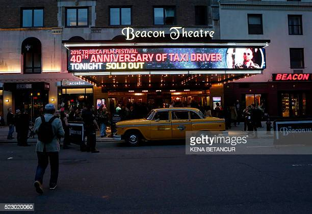 People arrive to attend the 'Taxi Driver' 40th Anniversary Celebration during the 2016 Tribeca Film Festival at The Beacon Theatre in New York on...