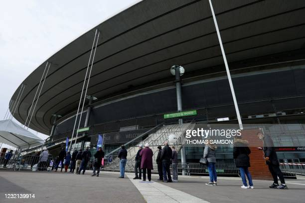 People arrive to be vaccinated against Covid-19 at a vaccination centre set up at the Stade de France , in Saint-Denis, outside Paris on April 6,...