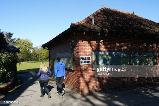 People arrive to cast their vote in the Hartlepool by-election at a polling station on May 06, 2021 in Hartlepool, England. Today voters in...