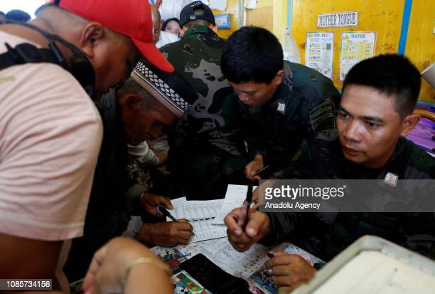 People arrive to cast their votes at Sero Sentral Elementary School during the referendum in Maguindanao Philippines on January 21 2019 The...