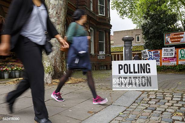 People arrive to cast their votes in the EU referendum at Islington district of London in United Kingdom on June 23 2016 Voting has begun in the...
