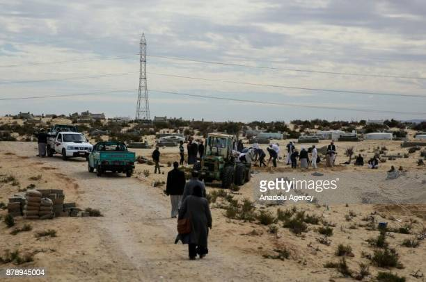 People arrive to cemetery to bury victims of the of the Egypt Sinai mosque bombing in AlArish Egypt on November 25 2017 The death toll in the attack...